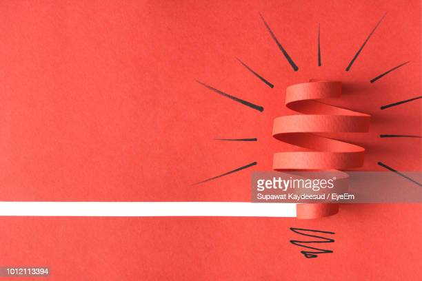 high angle view of red paper and drawing on table - light bulb stock pictures, royalty-free photos & images