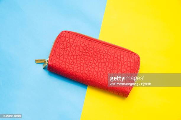 High Angle View Of Red Purse On Table