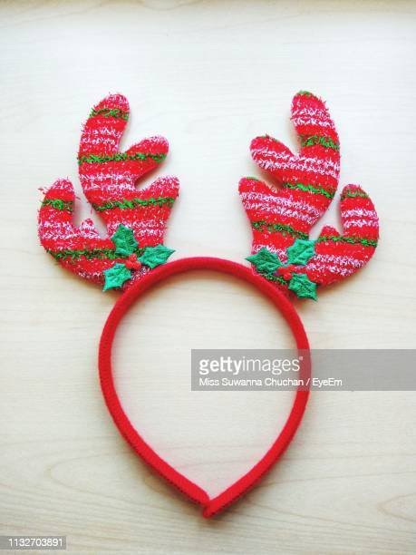 high angle view of red reindeer antler headband on table - antler stock pictures, royalty-free photos & images