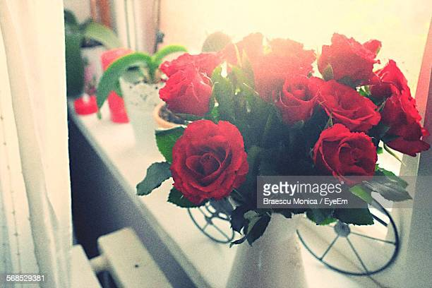 High Angle View Of Red Roses In Vase On Window Sill