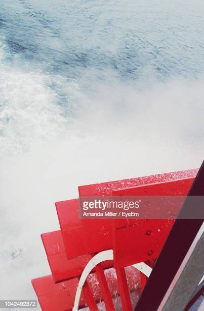High Angle View Of Red Steps By Sea
