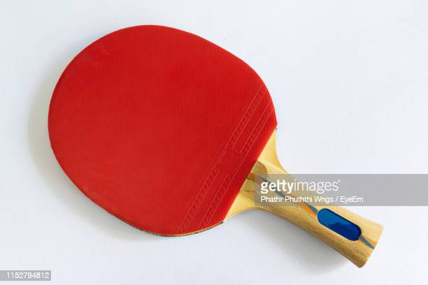 high angle view of red table tennis bat against white background - racquet stock pictures, royalty-free photos & images