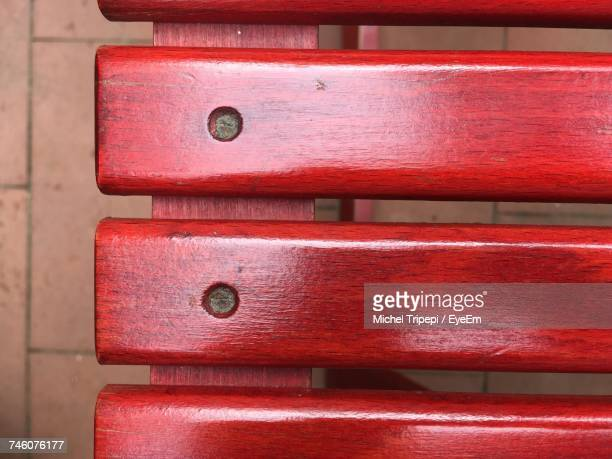 High Angle View Of Red Wooden Bench