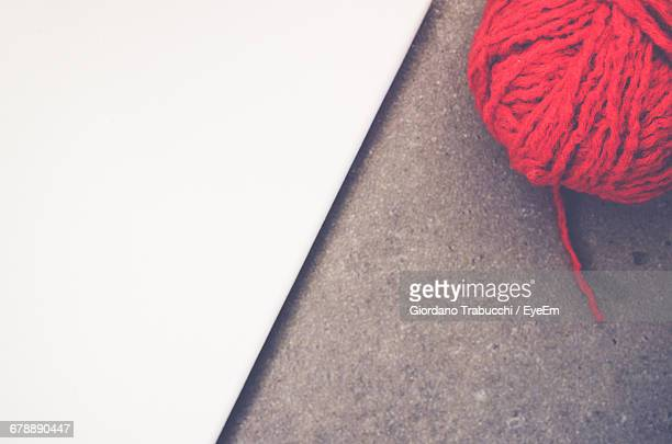 High Angle View Of Red Woolen Ball