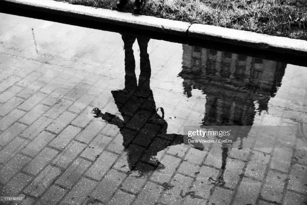 High Angle View Of Reflection In Puddle : Photo