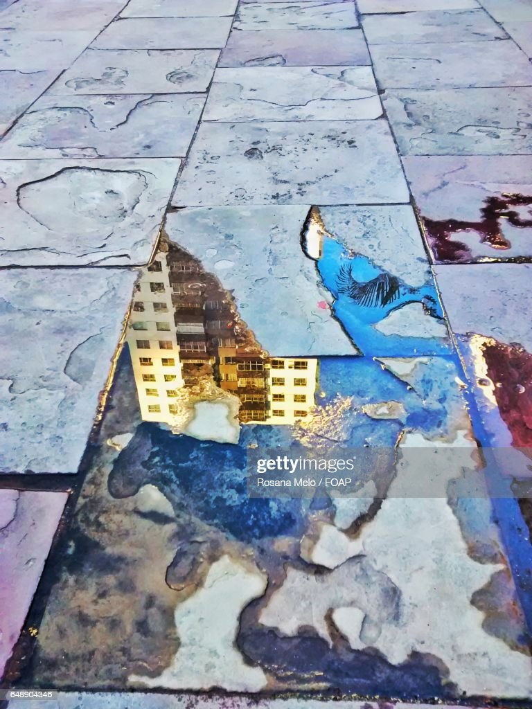 High Angle View Of Reflection In Water On Tiled Floor Stock Photo ...