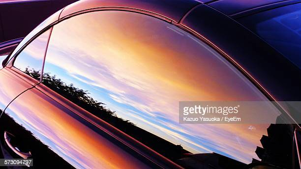 high angle view of reflections on car window - spiegelung stock-fotos und bilder
