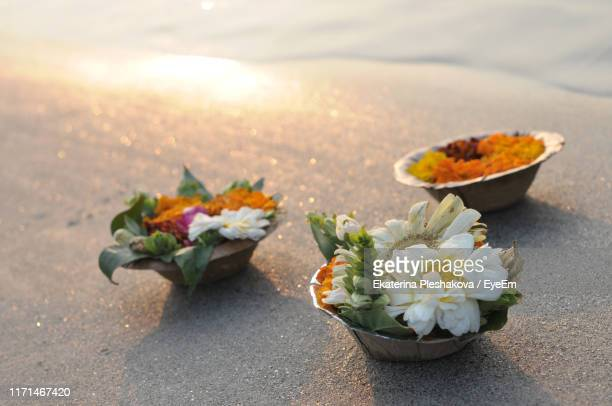 high angle view of religious offerings at beach - ganges river stock pictures, royalty-free photos & images