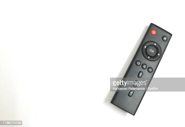 high angle view of remote control against white background - remote control stock pictures, royalty-free photos & images