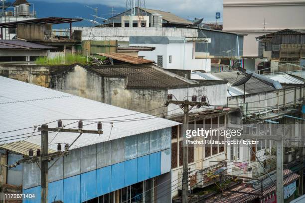 high angle view of residential buildings against sky - phichet ritthiruangdet stock photos and pictures