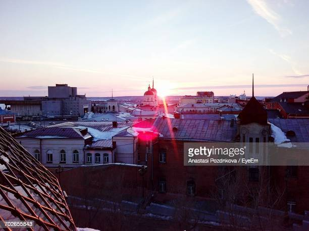 high angle view of residential buildings at sunset - anastasi foto e immagini stock