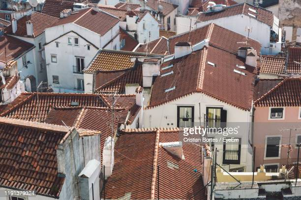 high angle view of residential buildings in city - bortes stock photos and pictures