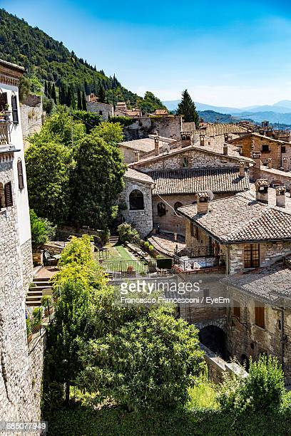 high angle view of residential buildings in town against clear blue sky - gubbio stock pictures, royalty-free photos & images