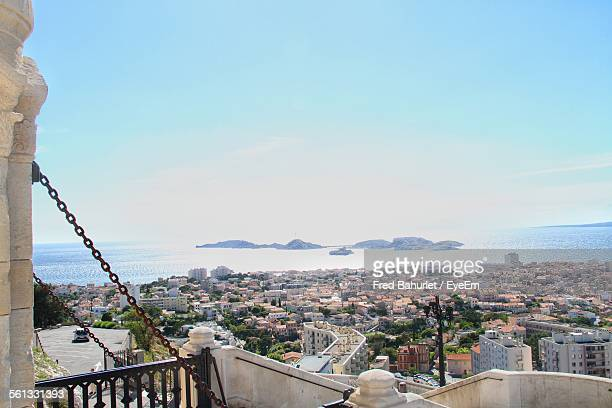 high angle view of residential district by sea against sky - marseille stock pictures, royalty-free photos & images