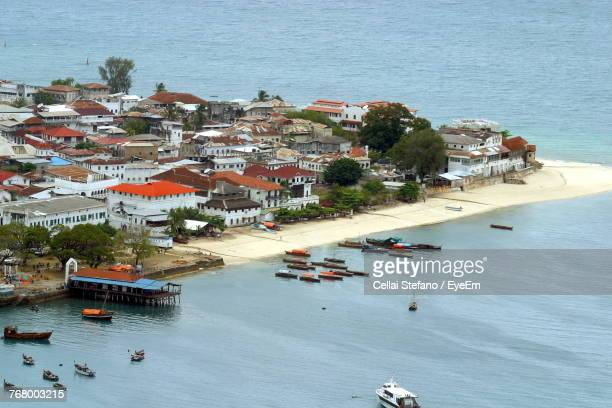 high angle view of residential district by sea - tansania stock-fotos und bilder