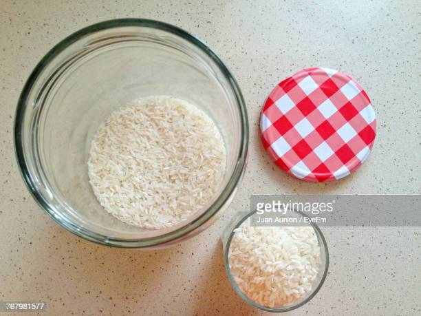 high angle view of rice in bowl on table - lid foto e immagini stock