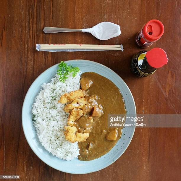 High Angle View Of Rice With Curry Served On Table