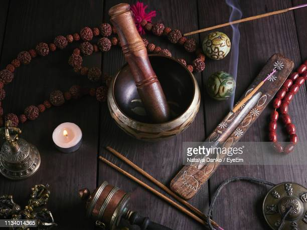 high angle view of rin gong with religious equipment on table - gong stock pictures, royalty-free photos & images