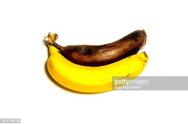 High Angle View Of Ripe And Rotten Bananas On White Background