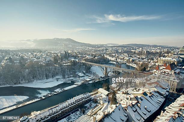 High angle view of river Aare and city with snow covered rooftops, Berne, Switzerland