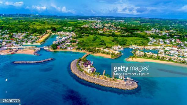 high angle view of river against cloudy sky - bridgetown barbados stock photos and pictures