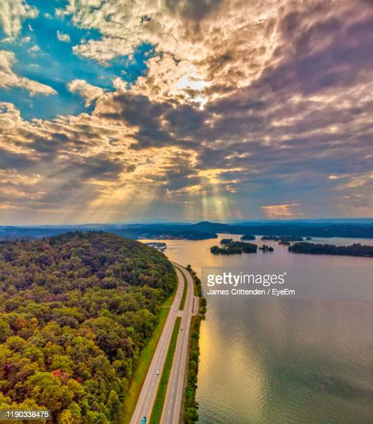 high angle view of river against sky at sunset - tennessee stock pictures, royalty-free photos & images
