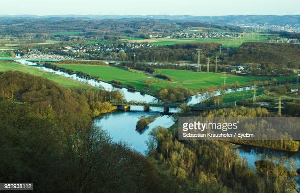 high angle view of river along landscape - sebastian kraushofer stock-fotos und bilder