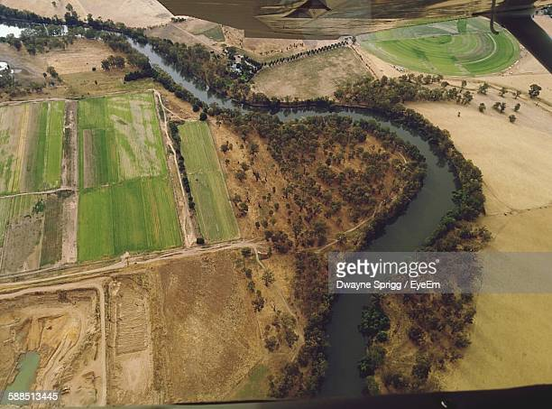 high angle view of river amidst agricultural field - ワガワガ ストックフォトと画像