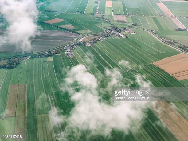 high angle view of river amidst agricultural landscape - bortes stock photos and pictures