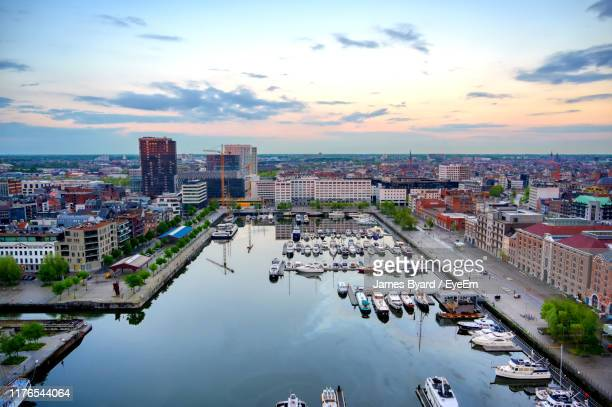 high angle view of river amidst buildings in city against sky - antwerpen stad stockfoto's en -beelden