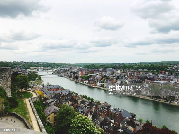high angle view of river amidst buildings in city against sky - belgium stock pictures, royalty-free photos & images