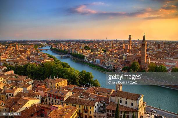 high angle view of river amidst buildings in city - veneto stock pictures, royalty-free photos & images