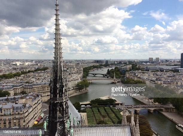 high angle view of river amidst buildings in city - rouen stock pictures, royalty-free photos & images