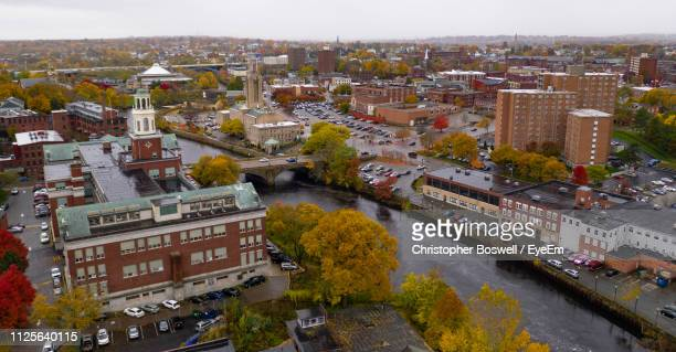 high angle view of river amidst buildings in city - rhode island stock pictures, royalty-free photos & images