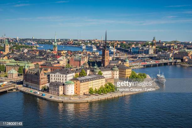 high angle view of river amidst buildings in city - stockholm stock pictures, royalty-free photos & images