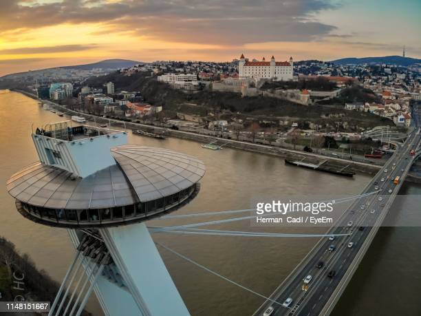 high angle view of river amidst buildings in city - bratislava stock pictures, royalty-free photos & images