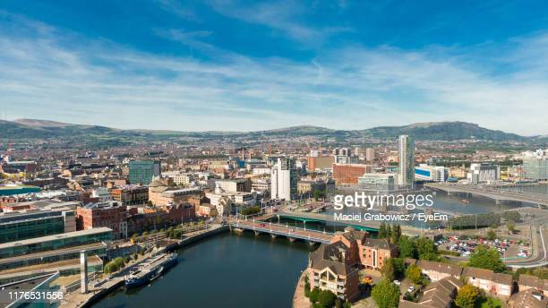 high angle view of river amidst buildings in city - belfast stock pictures, royalty-free photos & images