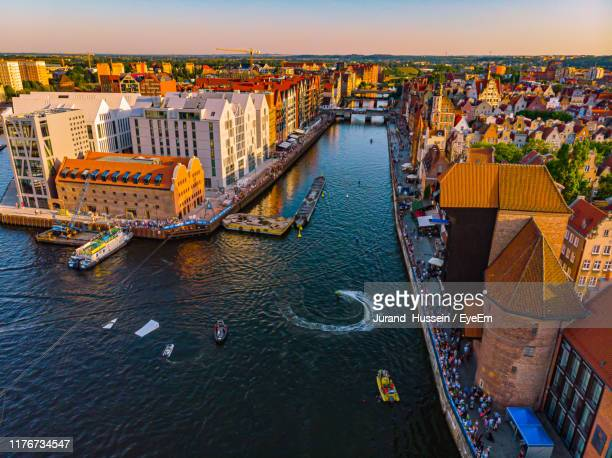 high angle view of river amidst buildings in city - gdansk stock pictures, royalty-free photos & images
