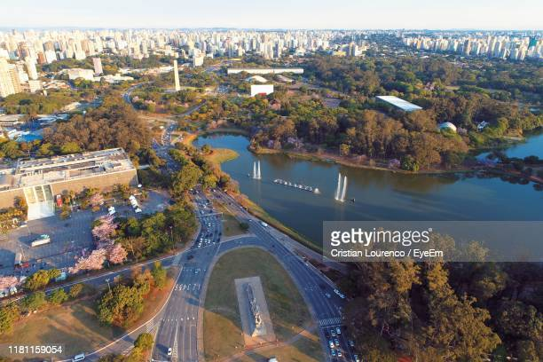 high angle view of river amidst buildings in city - ibirapuera park stock pictures, royalty-free photos & images