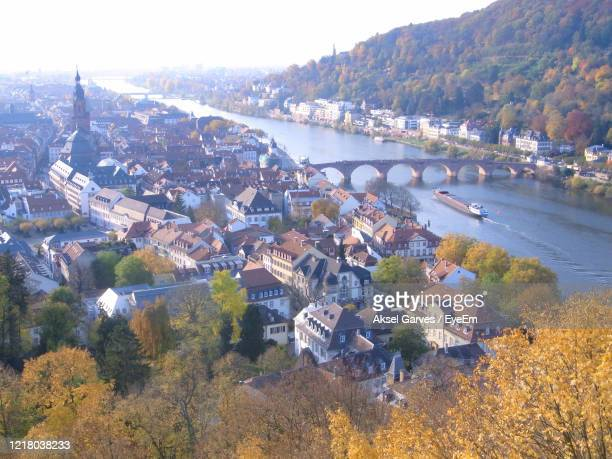 high angle view of river amidst buildings in city - aksel garves stock-fotos und bilder
