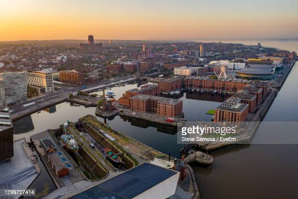 high angle view of river amidst buildings in city - liverpool england stock pictures, royalty-free photos & images