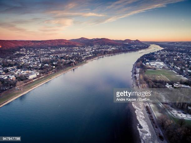 high angle view of river amidst buildings in city - bonn stock-fotos und bilder