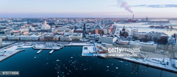 high angle view of river amidst buildings in city - helsinki stockfoto's en -beelden