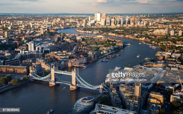 high angle view of river amidst buildings in city - london bridge england stock pictures, royalty-free photos & images
