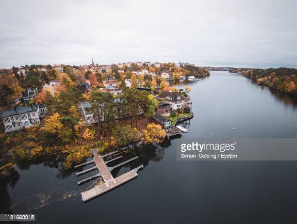 high angle view of river amidst cityscape against sky - colbing stock pictures, royalty-free photos & images