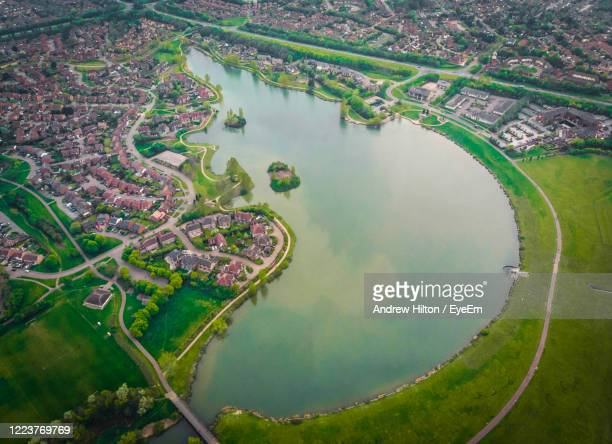 high angle view of river amidst cityscape - milton keynes stock pictures, royalty-free photos & images