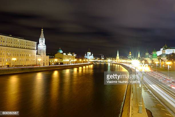 high angle view of river amidst illuminated city at night - rostov on don stock pictures, royalty-free photos & images