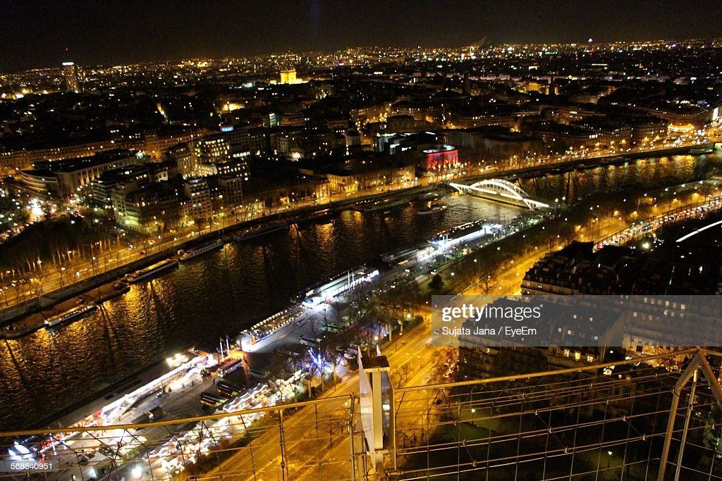 High Angle View Of River Amidst Illuminated City : Stock Photo