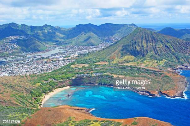 high angle view of river amidst mountains against blue sky - diamond head stock photos and pictures