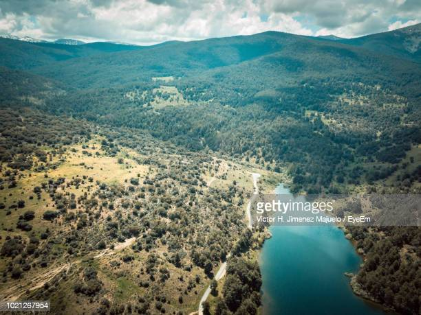 high angle view of river amidst mountains against sky - segovia stock pictures, royalty-free photos & images